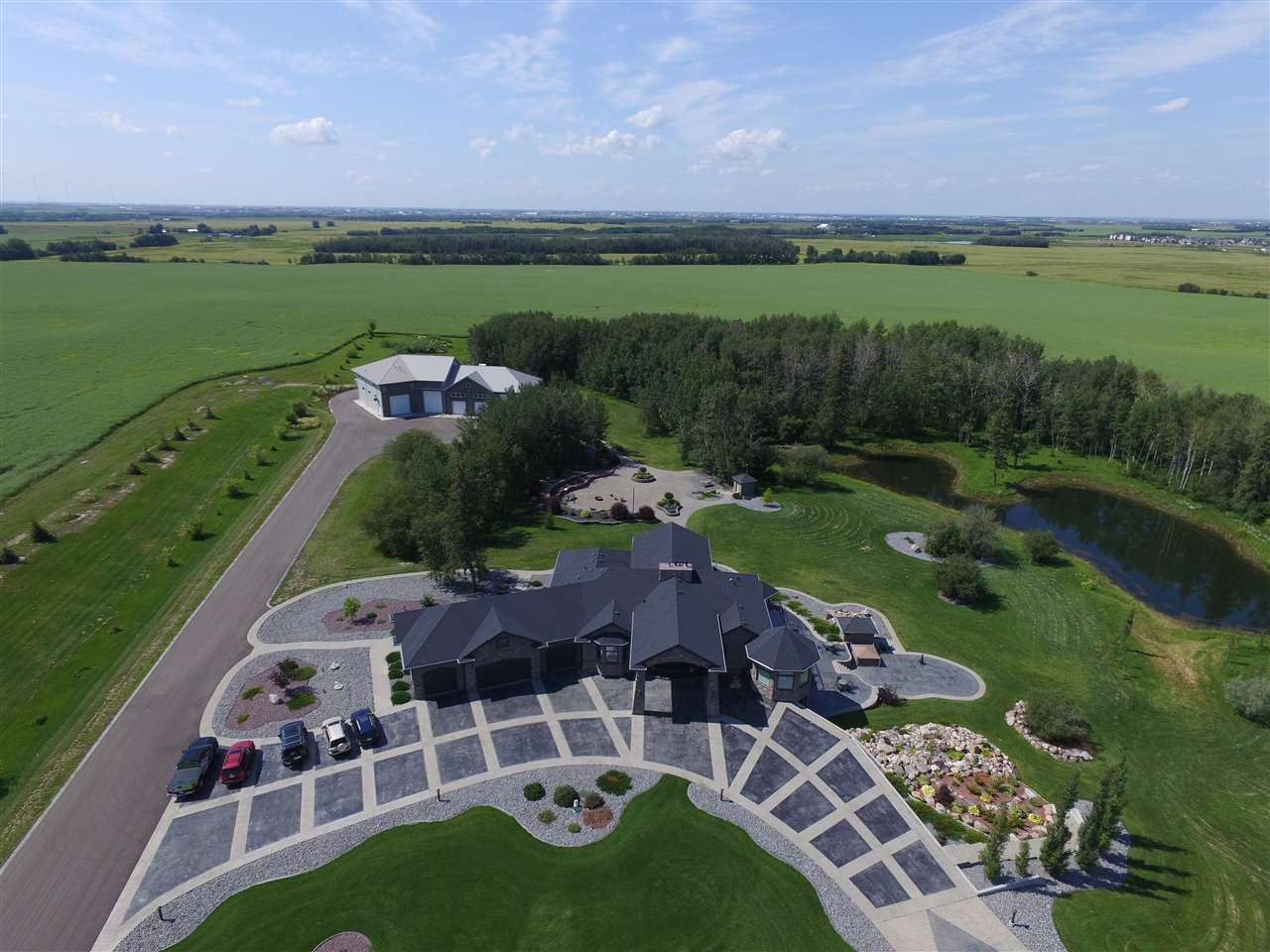 A stunning property on 160 acres with a luxury home and amazing shop with living quarters!