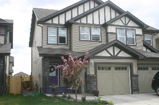 Main Photo: 7039 174 Avenue in Edmonton: Zone 28 House Half Duplex for sale : MLS(r) # E4065532