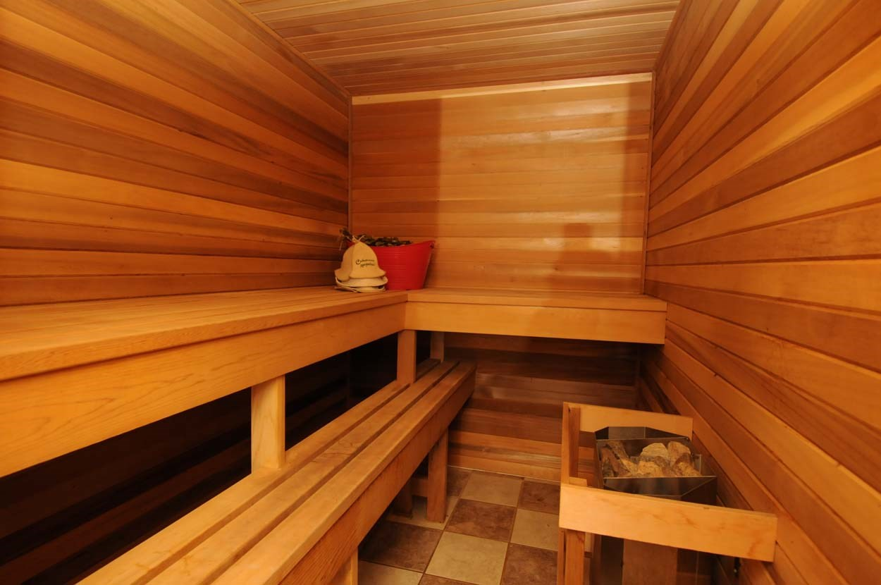 Finland style sauna built with red Canadian cedar with volcanic rocks to keep you always steaming hot and healthy.