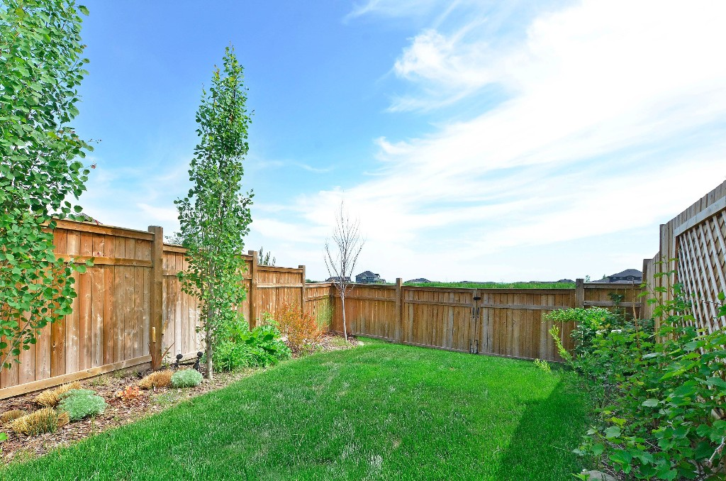 A gate at the back makes it easy if you need to bring large equipment in the yard 91 Drake Landing Loop, Okotoks Real Estate Listing