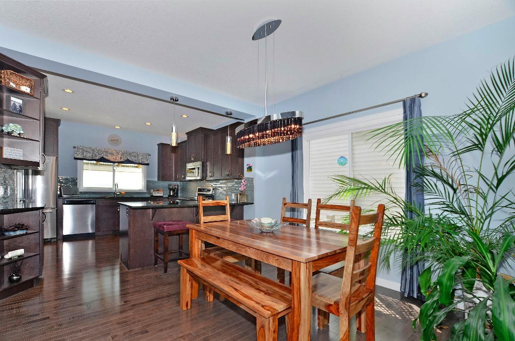 Hardwood floor flows throughout the entire main floor 91 Drake Landing Loop, Okotoks Real Estate Listing
