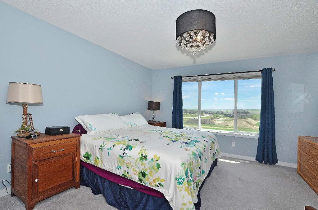 The master bedroom is a large size fitting a king size bed...you can see the mountains on a clear day from this window 91 Drake Landing Loop, Okotoks Real Estate Listing