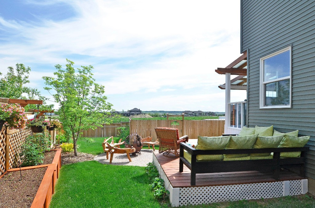 The whole yard is irrigated and beautifully landscaped 91 Drake Landing Loop, Okotoks Real Estate Listing