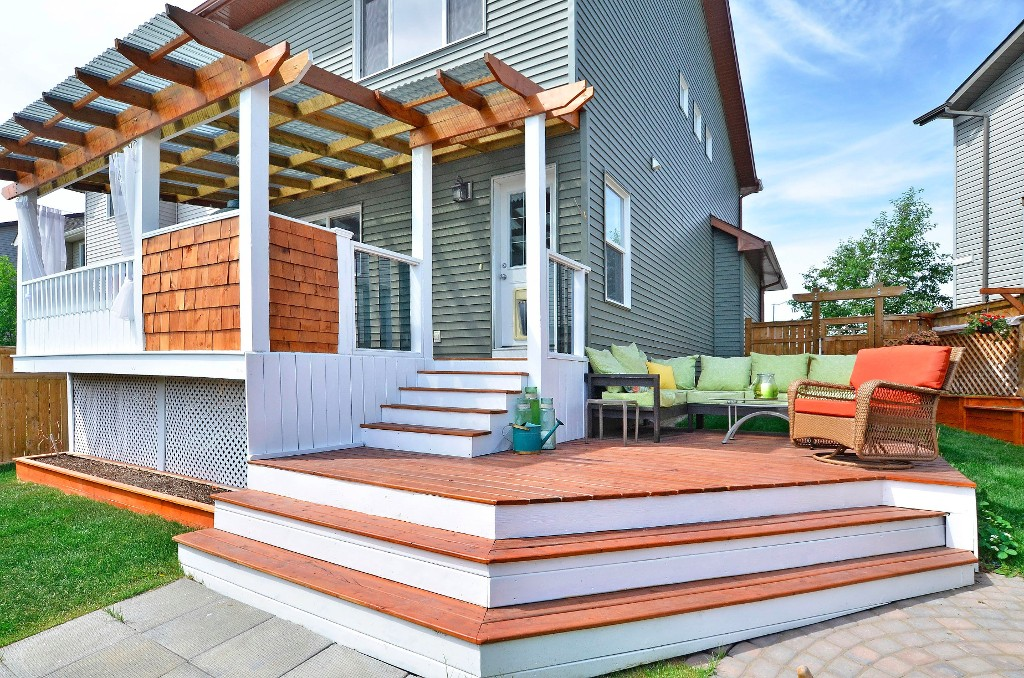 The landscaping in this home is absolutely breathtaking. Two-tier deck..one for dining in and the other for lounging in. 91 Drake Landing Loop, Okotoks Real Estate Listing