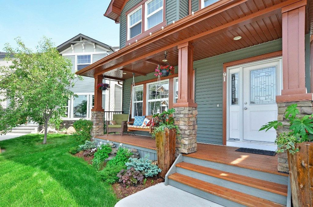 Beautifully landscaped with a covered front porch 91 Drake Landing Loop, Okotoks Real Estate Listing