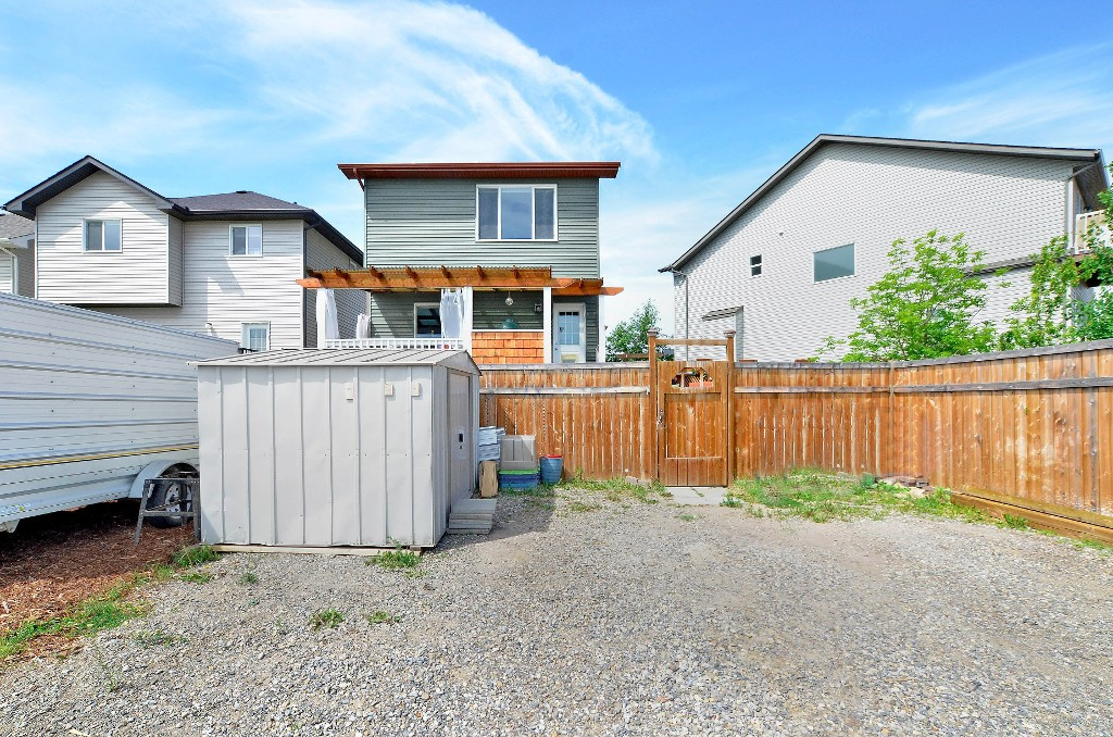 A storage shed comes with the property, however there is room enough to build a triple car garage if that is what you need 91 Drake Landing Loop, Okotoks Real Estate Listing