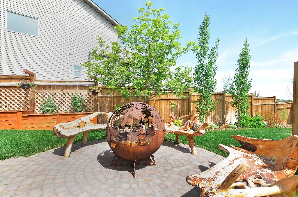 And when the sun goes down, enjoy a fire on the stamped patio (sorry, firepit won't be staying) 91 Drake Landing Loop, Okotoks Real Estate Listing
