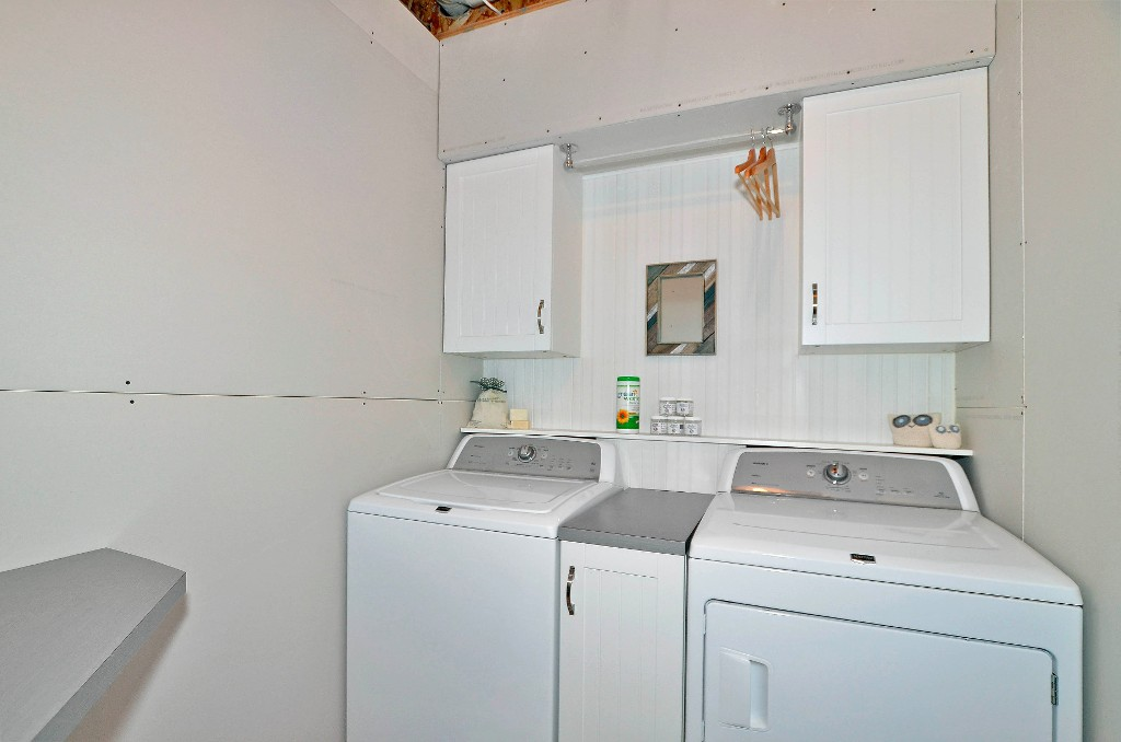 Laundry room is in the basement which is partially finished..the walls are erected and drywalled. 91 Drake Landing Loop, Okotoks Real Estate Listing