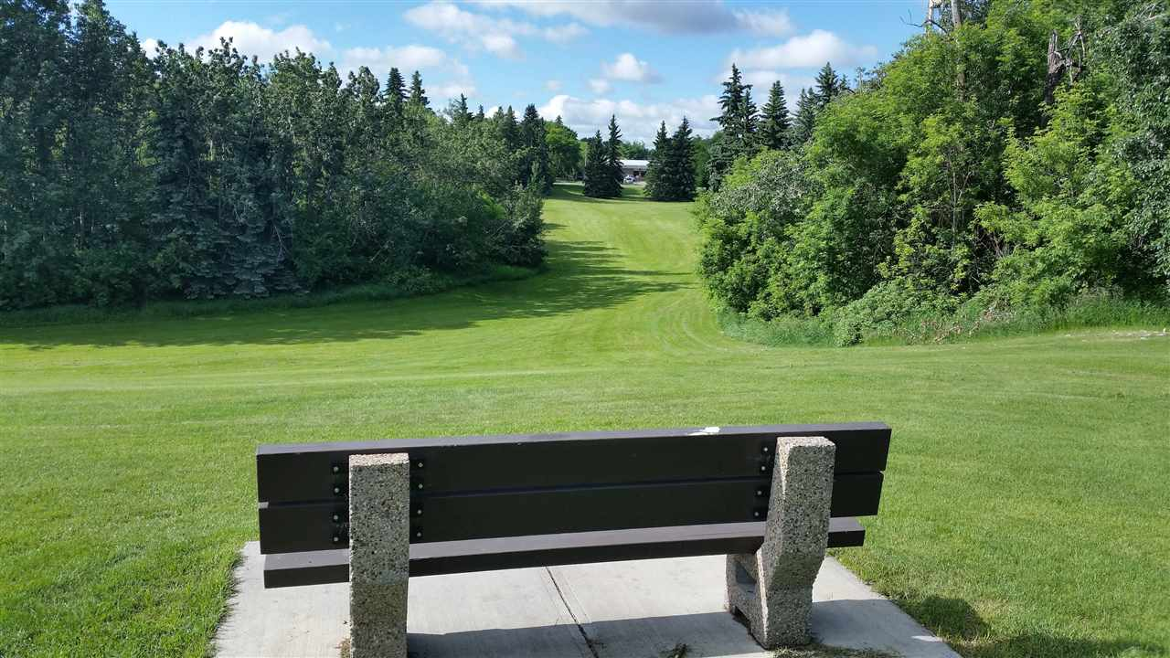 "If you desire a quiet area with a beautiful park a few steps away....this home offers that. This bench may be just what is needed on those ""rat race"" days....when it feels like the rats are winning.   A great place for the little ones who may visit."
