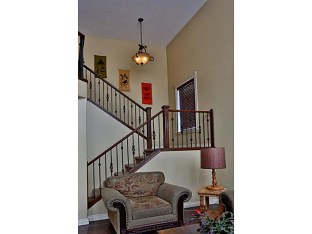 Upgraded spindles and bright open staircase