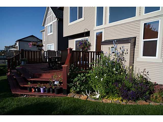 Large deck, family friendly yard, lots of plants.