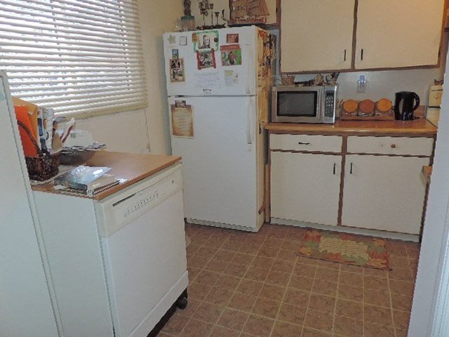 Room for a small kitchen table or option to use original dining area.