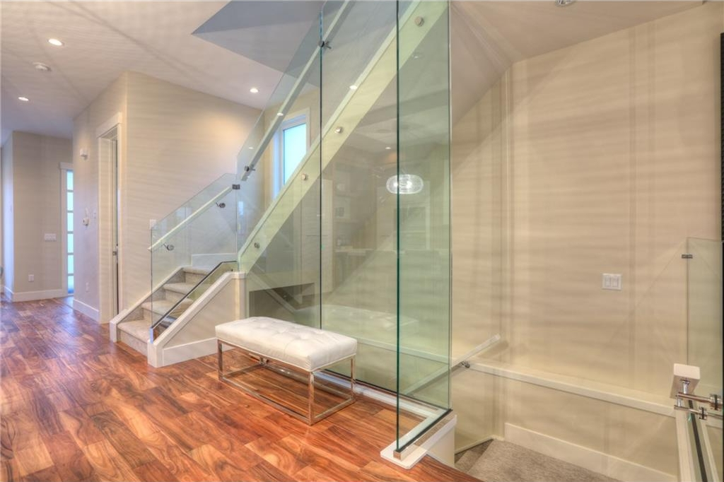 Home has modern flair with glass railing.
