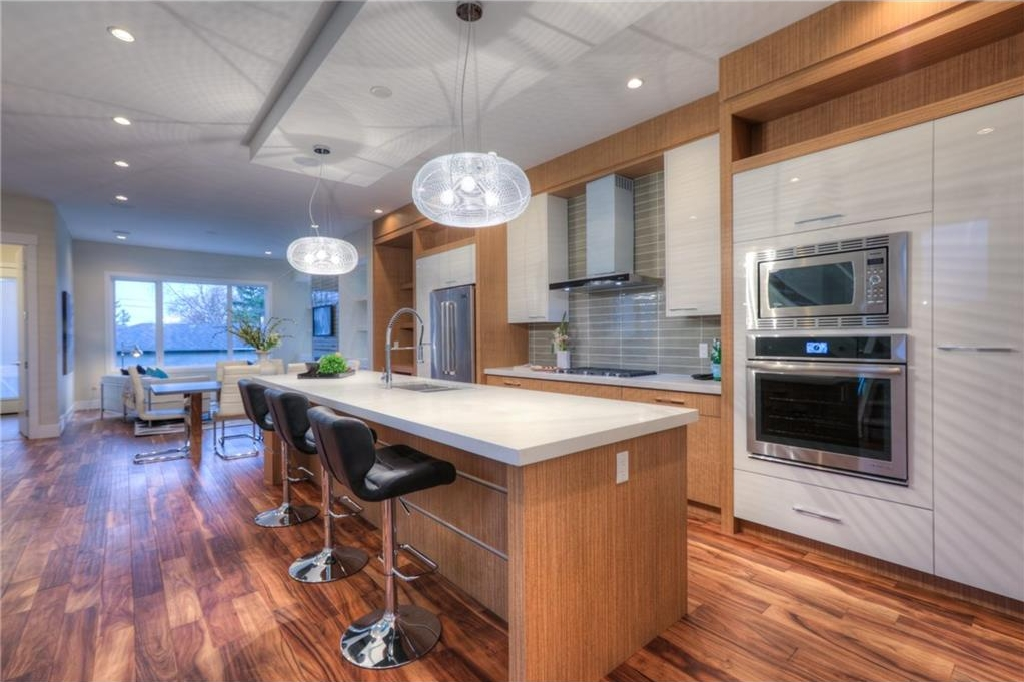 Gourmet kitchen with massive island breakfast bar, Jenn-Air Appliances and modern lighting package.