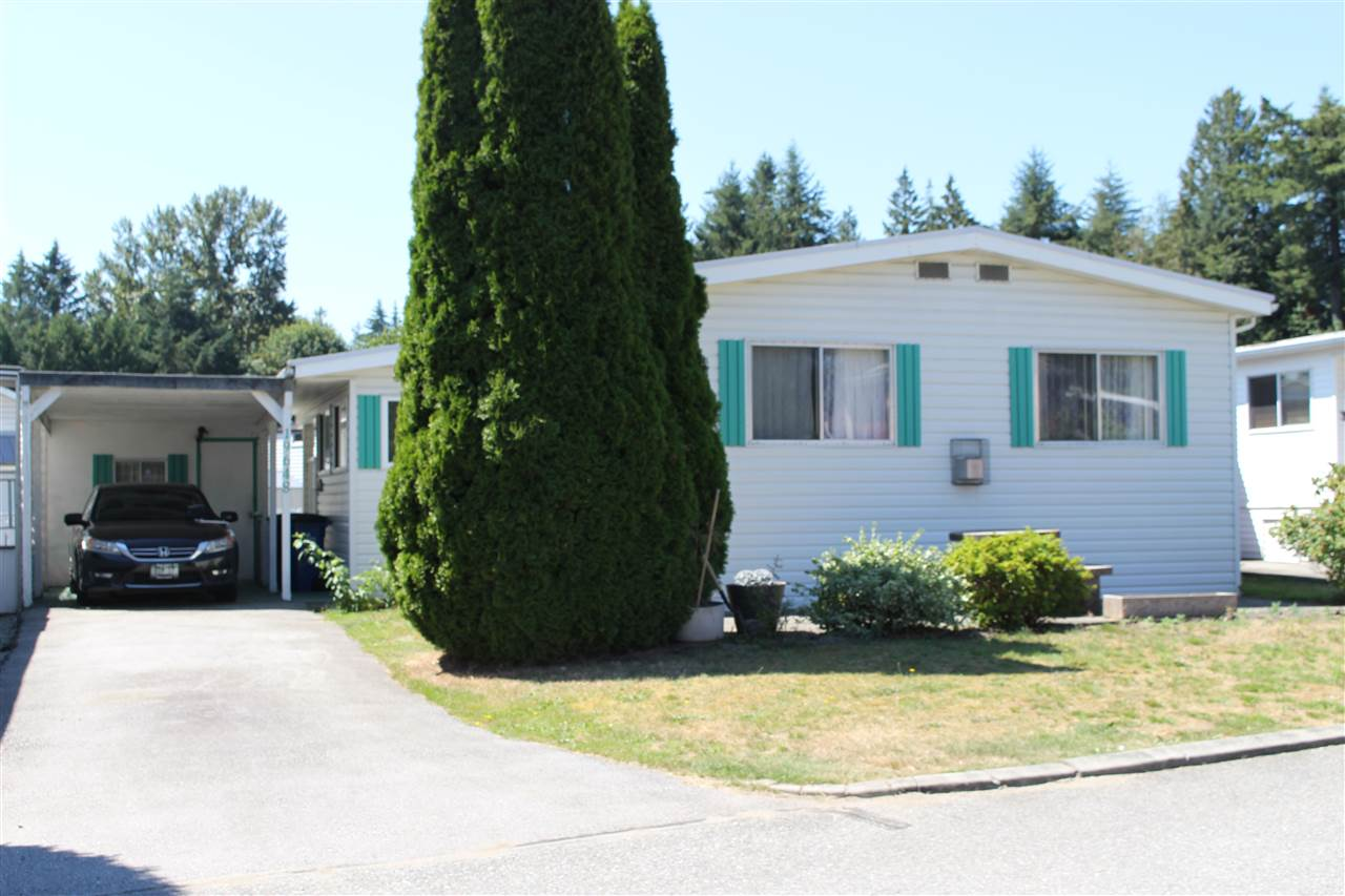 "Main Photo: 19648 PINETREE Lane in Pitt Meadows: Central Meadows Manufactured Home for sale in ""MEADOW HIGHLANDS"" : MLS®# R2289897"