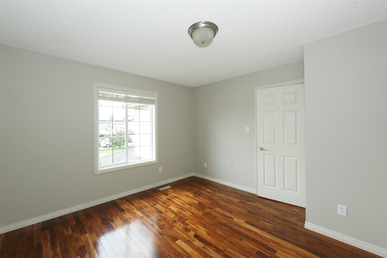 Second bedroom, with double closet and hardwood flooring found in all of the upper level bedrooms and bonus room