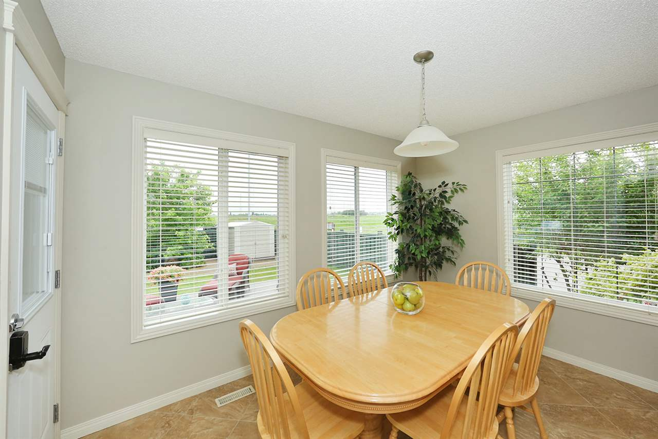 Large eating nook with plenty of windows and access to the deck and fully fenced yard