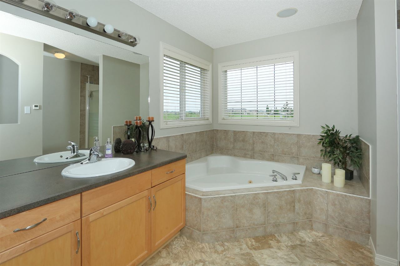 Master Ensuite with corner soaker tub, separate shower, and heated floors...even your feet will love this space!