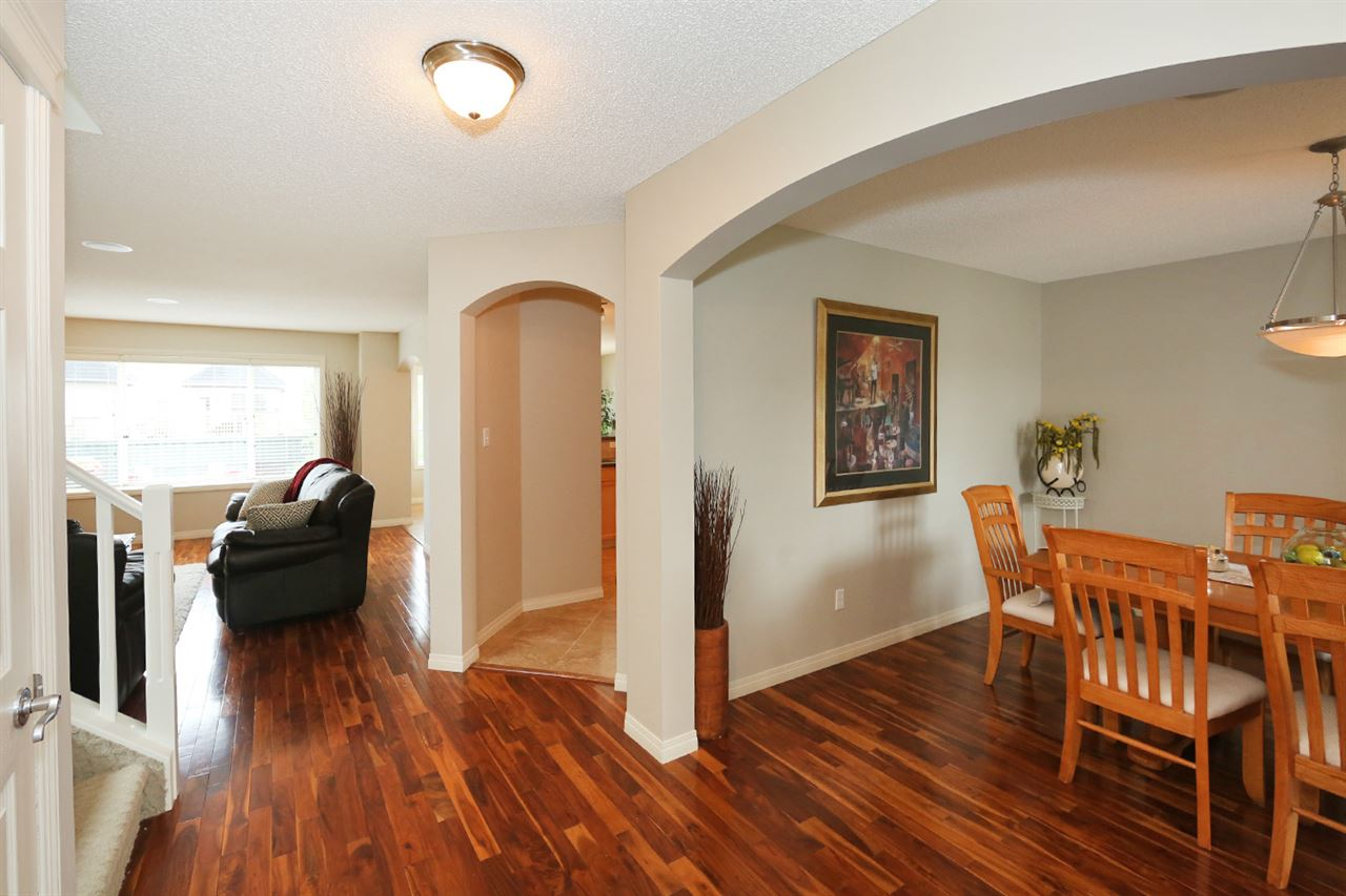 From the entrance, stunning hardwood floors extend throughout the main living areas