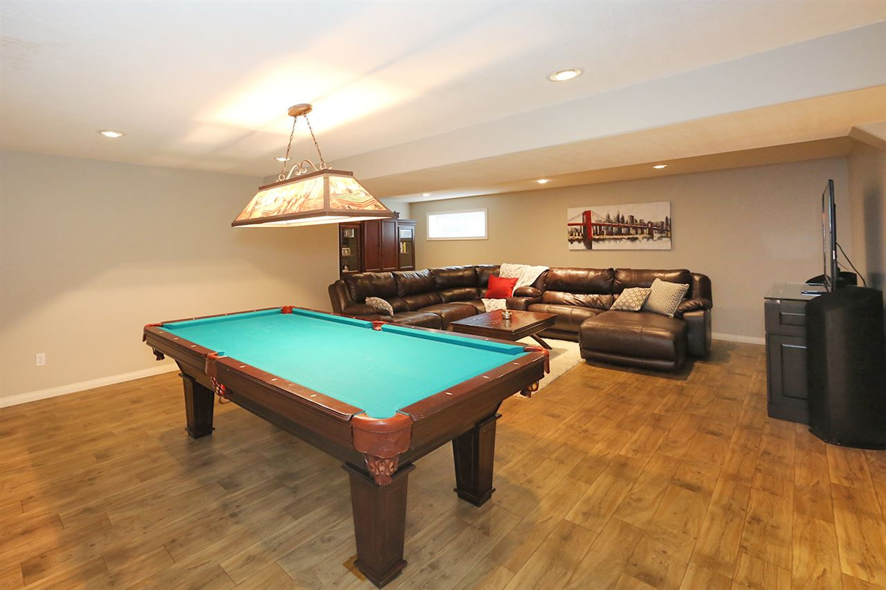 This lower level rec space is huge and has a nice open plan, in-floor heat throughout, and an awesome space to hang out and play pool (pool table included!)
