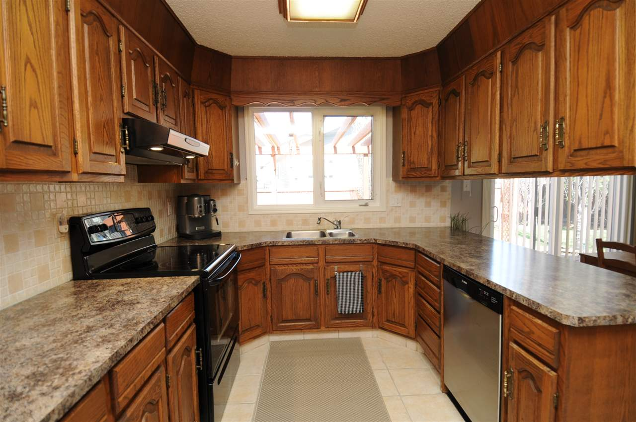 Lots of cabinets and a good amount of counter space with a window looking into the backyard to keep an eye on two legged and four legged family members.
