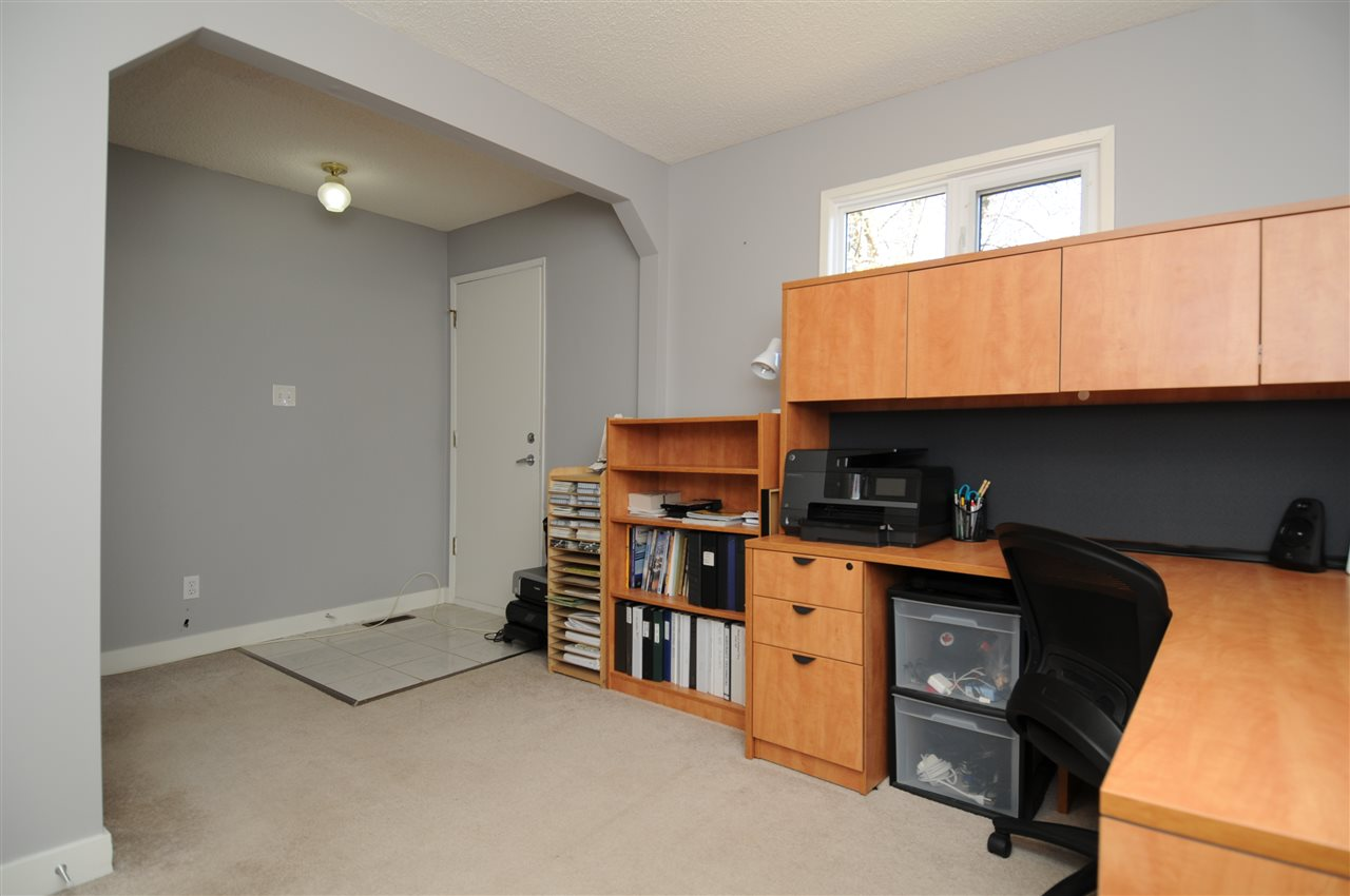 This main floor room could be a bedroom, or an office for a home based business with a convenient separate entrance.