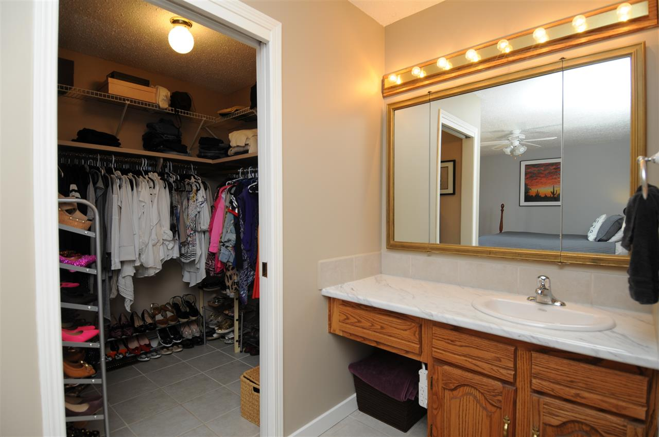 The full walk-in closet and make up counter with Hollywood lighting will be nice to have.