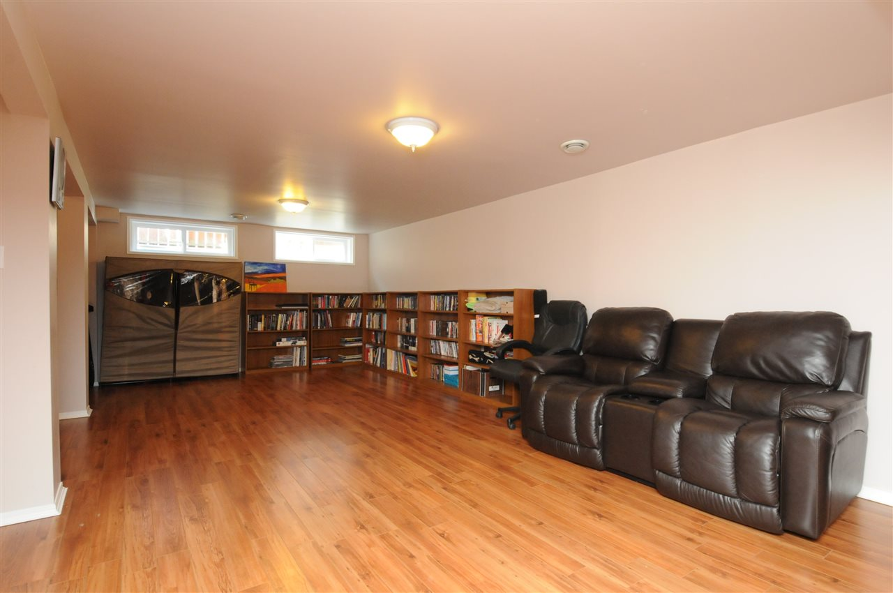 This very large family room in the basement provides extra space for the family.