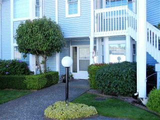 "Main Photo: 105 9105 154 Street in Surrey: Fleetwood Tynehead Townhouse for sale in ""Lexington Square"" : MLS®# R2293076"