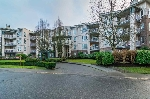 "Main Photo: 104 20200 54A Avenue in Langley: Langley City Condo for sale in ""Monterey Grande"" : MLS®# R2023129"