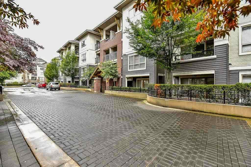 "Main Photo: A401 8929 202 Street in Langley: Walnut Grove Condo for sale in ""The Grove"" : MLS® # R2108220"