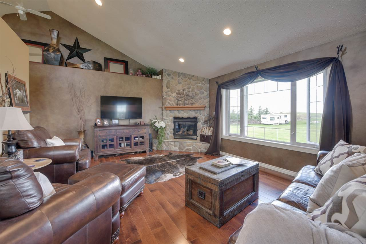 Living room features a stone facing gas fireplace