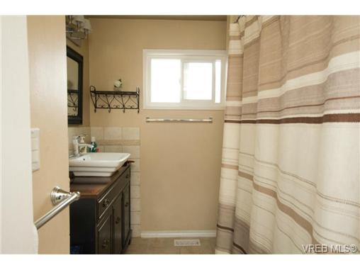 Main bathroom with updated fixtures and heated tile floors