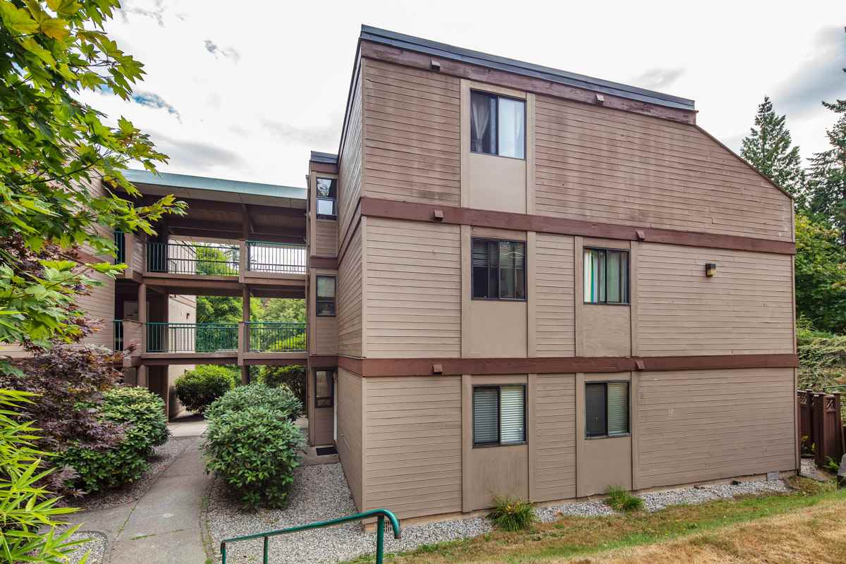 "Main Photo: 102 9143 SATURNA Drive in Burnaby: Simon Fraser Hills Townhouse for sale in ""MOUNTAINWOOD"" (Burnaby North)  : MLS® # R2197543"