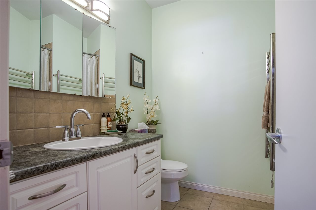 Beautifully Updated 4 pc. Main Bathroom with heated Tile Flooring and Towel Warmer Rack for those cooler days.