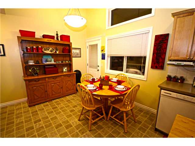 Photo 3: 58 CRYSTAL SHORES Cove: Okotoks Townhouse for sale : MLS(r) # C3643432