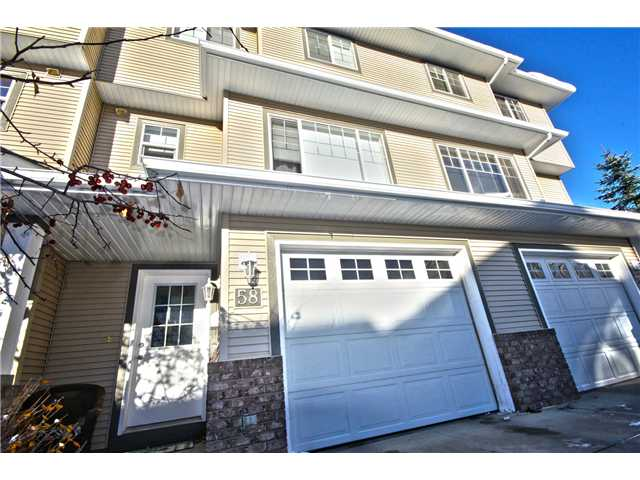 Main Photo: 58 CRYSTAL SHORES Cove: Okotoks Townhouse for sale : MLS(r) # C3643432