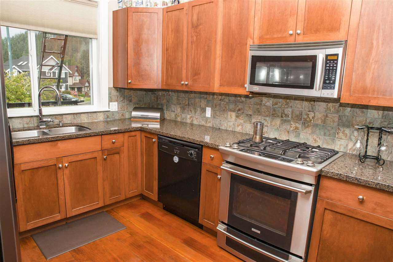 Upgraded appliances gas range and side by side fridge with icemaker. Kitchen sink window looks out at the western mountain peaks