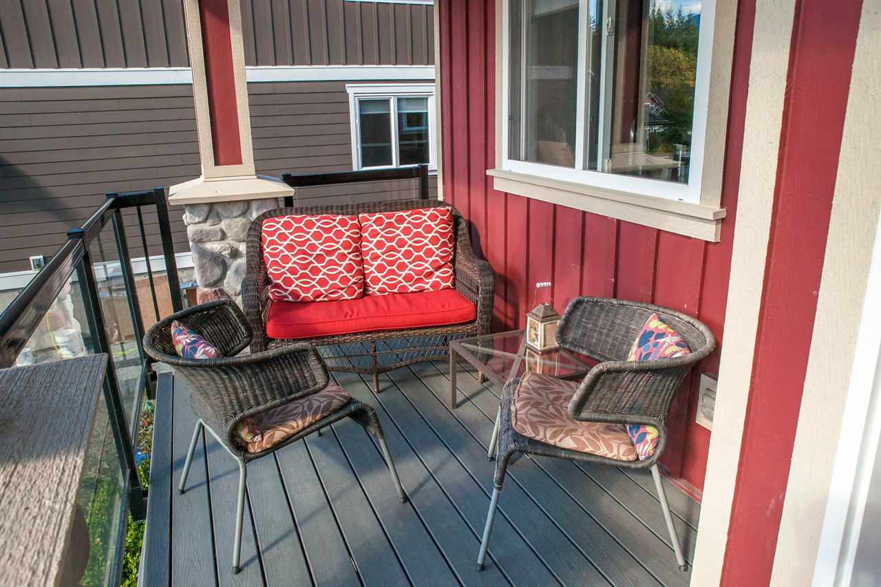 Extended front porch makes for a sunny spot to enjoy the views, read a book or sip a beverage.