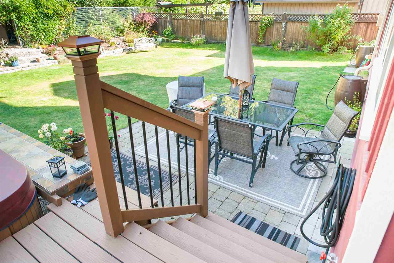 Rear yard is fully fenced and landscaped with a wonderful patio for entertaining.