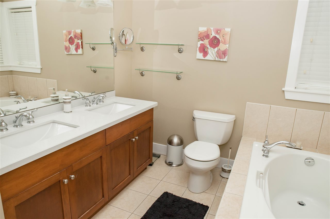 Ensuite features heated floors oversized soaker tub with separate shower and his and hers vanities.