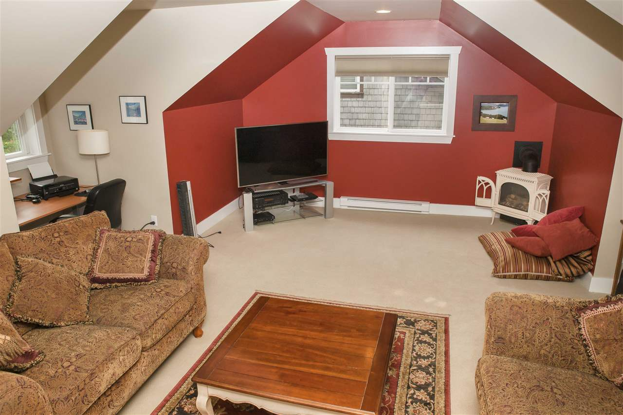 Upstairs you will find a flex family room space with gabled nooks and cozy fireplace