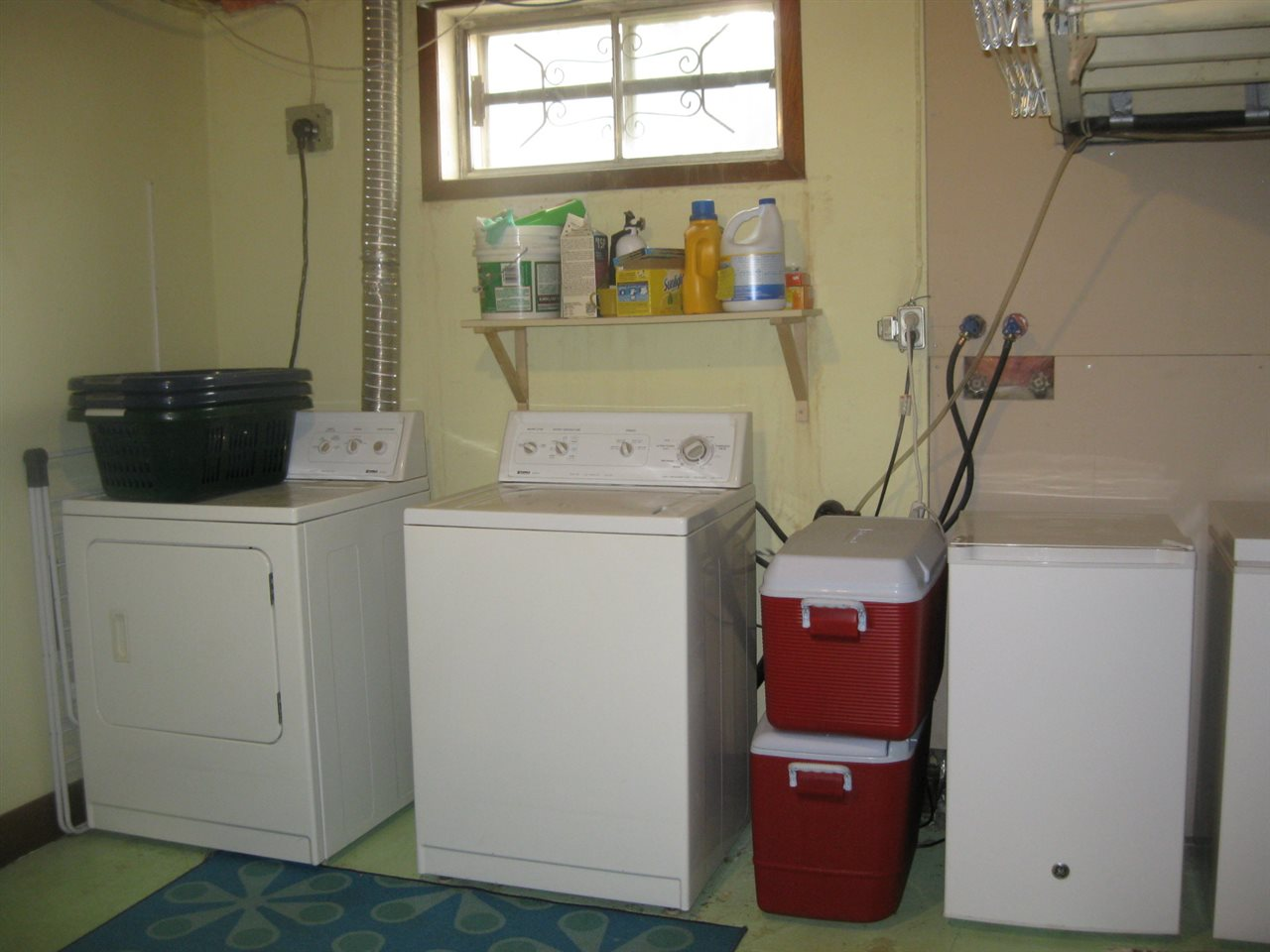 Large laundry room and storage.