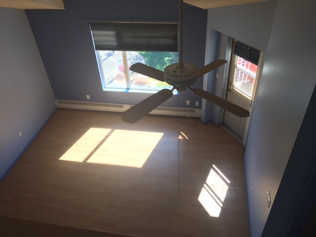 View looking down from the upper loft area which would be a great second bedroom (has large walk-in closet), den or bonus room!