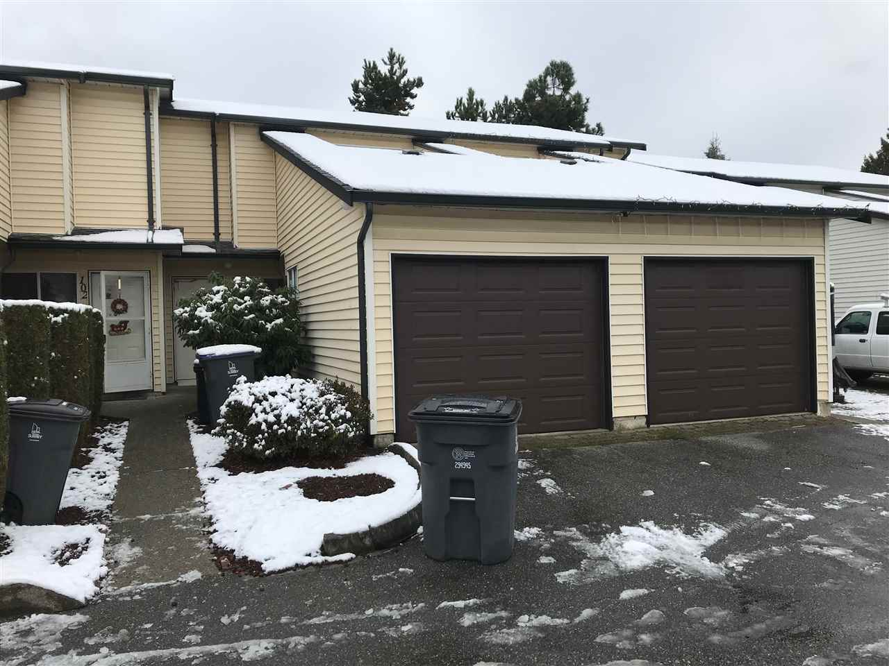 "Main Photo: 103 15519 87A Avenue in Surrey: Fleetwood Tynehead Townhouse for sale in ""Evergreen Estates"" : MLS® # R2229376"
