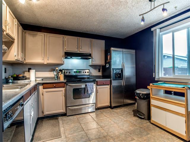 Photo 7: 27 Woodmont Green SW in Calgary: Woodbine House for sale : MLS® # C4022488