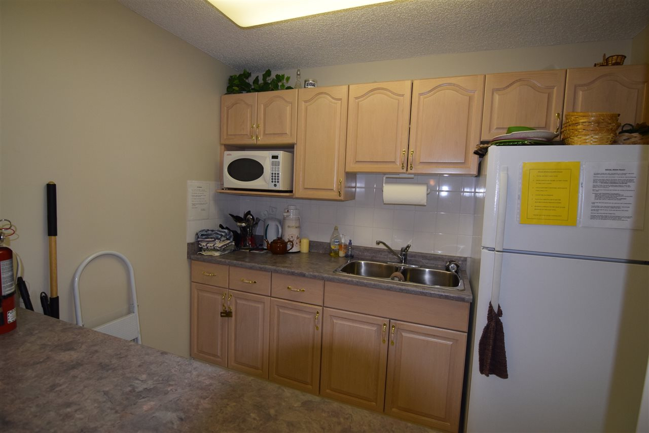 Kitchen in social room on main floor of condo