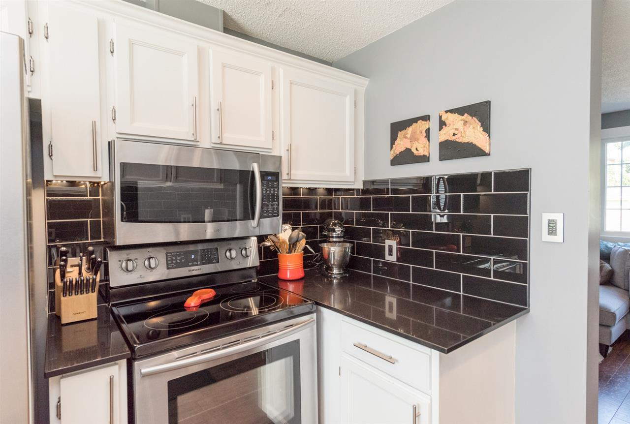 Quartz countertops and up-to-date backsplash...