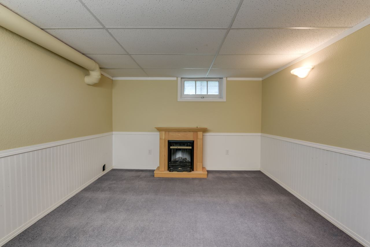 The full basement has loads of added space as seen here in the family room - awesome for TV and large gatherings.