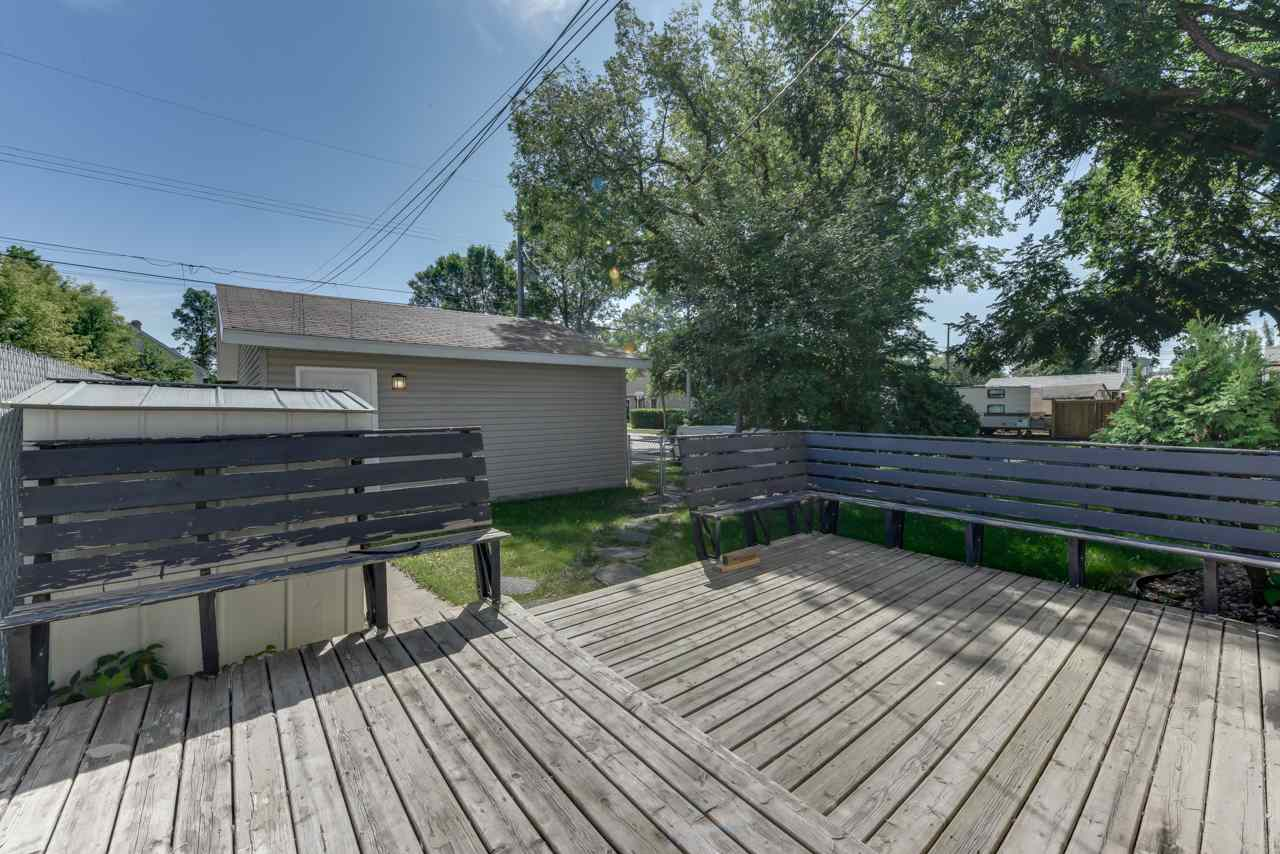 Deck with built-in seating, large fully-fenced yard are perfectly located on this tree-lined street.